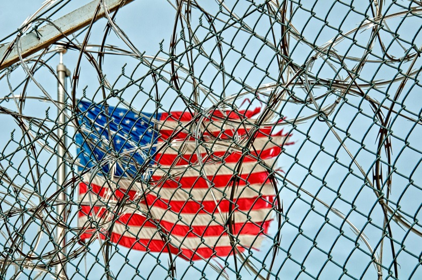 us flag behind fence